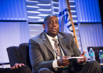 Marques Tibbs-Brewer, Regional Sales Executive, Concur, during a panel discussion at GovTravels 2017. (Photo by Cherie Cullen)