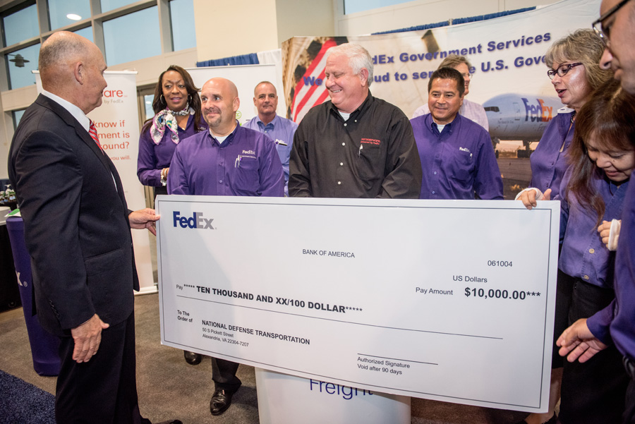 Rear Adm. Mark Buzby (ret.), NDTA's president, receives a $10K donation to the NDTA Foundation from FedEx Government. (Photo by Cherie Cullen)